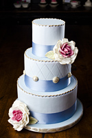 Three tier cake vintage blue with buttons with gumpaste roses