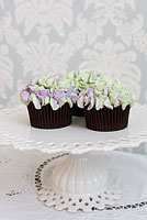 Green and pale purple buttercream hydrangea cupcakes.