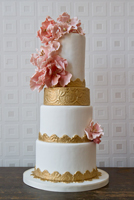 White tiers with vintage gold accent and pink sugar flowers