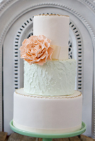 Subtle colour change and mixed textures accented with sugar peony
