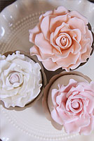 Pastel rose top sugar flower cupcakes.