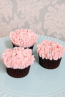 Pink buttercream carnation cupcakes.