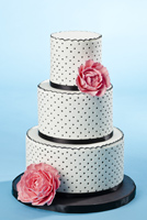 Three tier black and white polka dot cake with pink gumpaste peonies