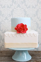 Vintage blue and cream cake with red rose sugar flower.